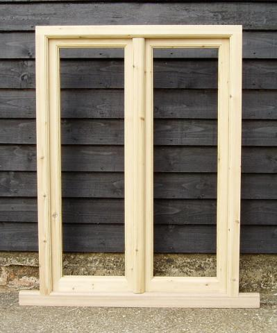 Storm proof window with fly mullion